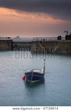 A traditional Cornish fishing village before sunrise