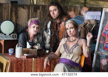 Fortune Tellers Sitting Outside