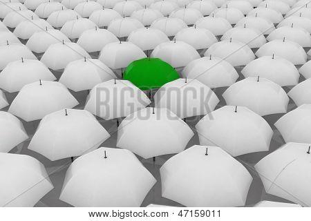 Green umbrella among other white umbrellas