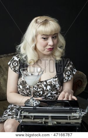 Beautiful Young Woman With Blond Hair Typing