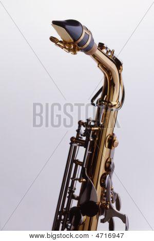 Close Up Of Saxophone Of Neck On White