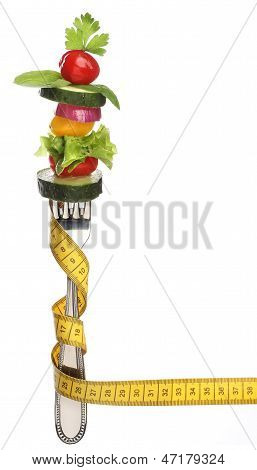 Mixed vegetables on a fork isolated. Diet concept