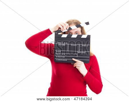 Young Woman Hiding Her Face Behind Clapperboard