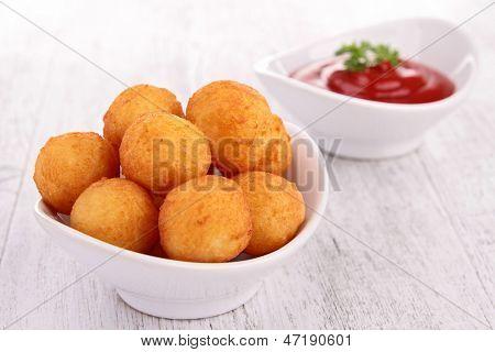 dauphine potato and ketchup
