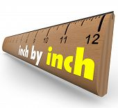 The words Inch by Inch on a wooden ruler to measure your incremental growth, increase or length poster
