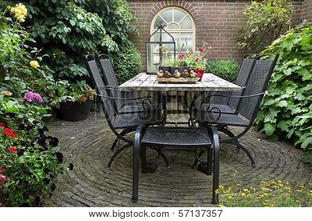 Iron Forged Table And Chairs In Garden
