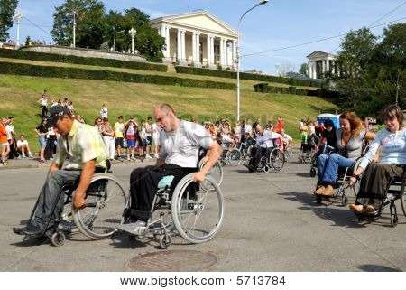 Arrival Of Invalids On Wheelchair.