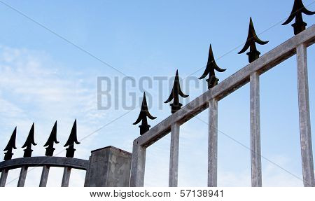 Closeup Of Decorative Security Spikes On Gate