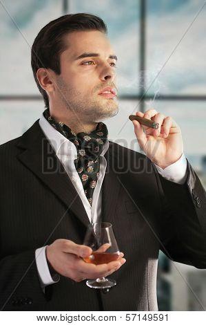 Man Smoking Cigar And Drinking Cognac