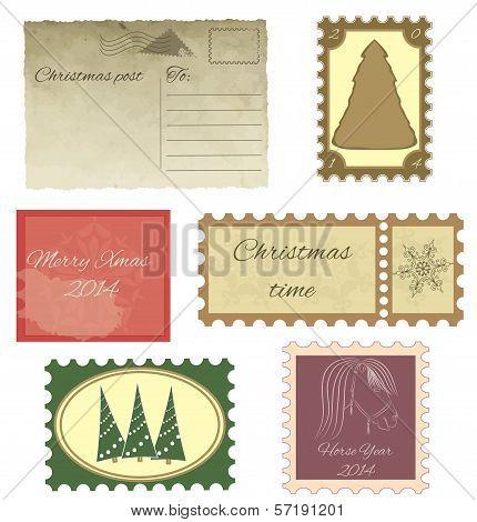 Set of vintage stamps and vintage postcard.