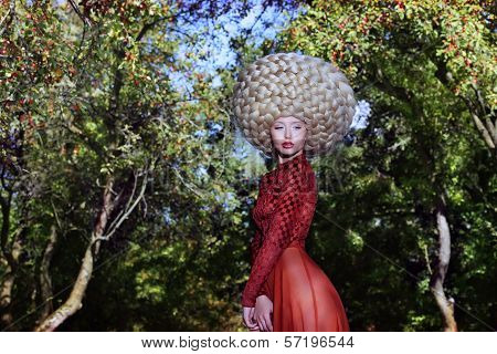 Fashion Style. Creativity. Eccentric Woman In Art Wig With Braids