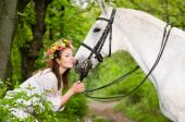 Smiling girl with horse in the forest poster
