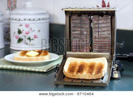 Vintage toaster, working in kitchen.