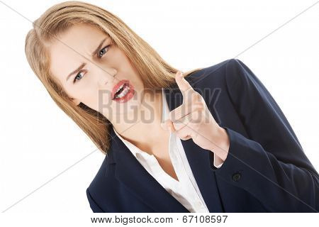 Beautiful business woman is showing warning sign. Over white.