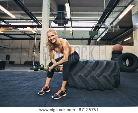 Female Athlete Taking Rest After Tough Workout