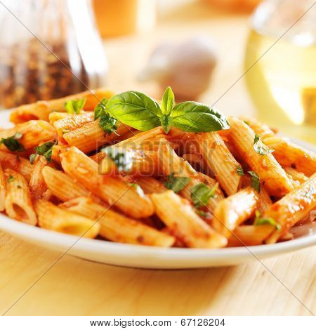 italian penne pasta smothered in tomato sauce