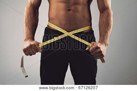 Fitness Man Measuring His Waist