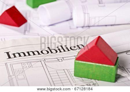 Small Building Blocks House On Blueprints