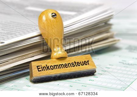 income tax marked on german rubber stamp poster