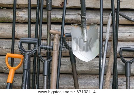 shovel near a wooden wall