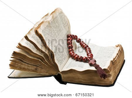 Open Bible And Wooden Rosary