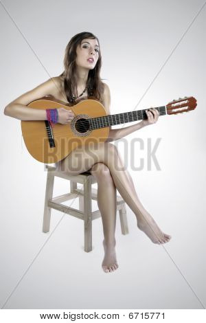 Nude Guitar Girl On A Chair