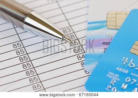 Pen And Credit Cards On A Financial Spreadsheet
