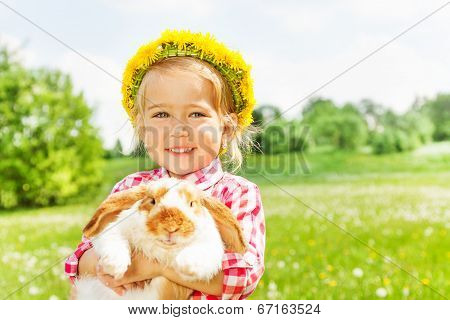 Happy blond girl with yellow flowers circlet