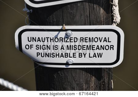 Sign - Unauthorized removal of sign