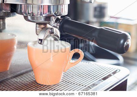 Orange Coffe Cup Prepares For Espresso