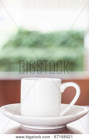 White Cup On Table In Coffee Shop