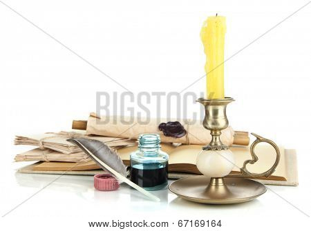 Old candleholder with candle isolated on white