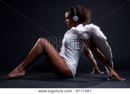 Alluring Woman In White Wings