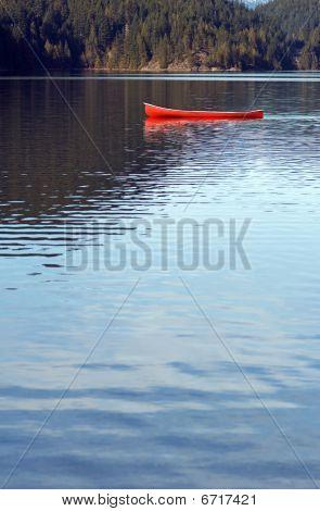 Empty Canoe On Lake