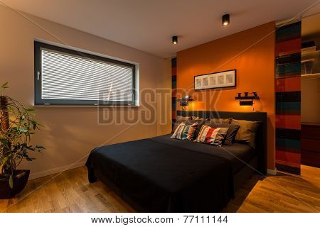 Designer Bedroom With Orange Wall