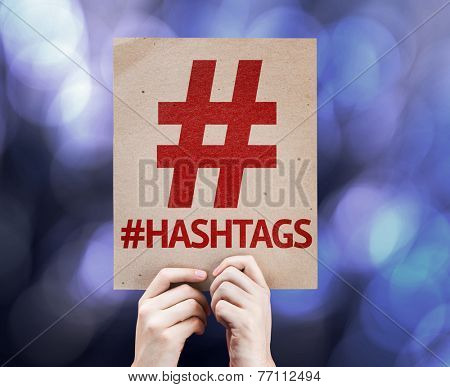 Hashtag Icon with #Hashtags written on colorful background with defocused lights