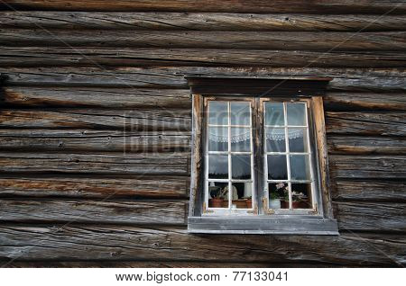 Dark timbered wooden wall with white window