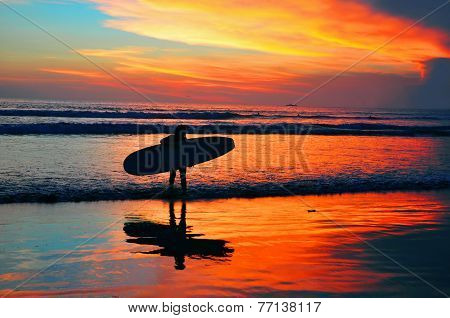 surfing on the sunset