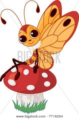 Cute butterfly on mushroom