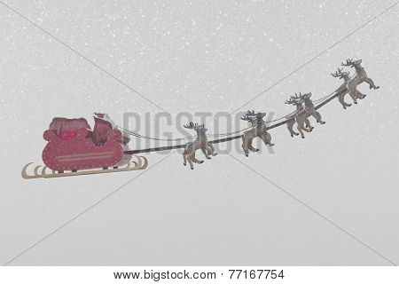Santa Claus taking off his sleigh led by reindeers on snow weather