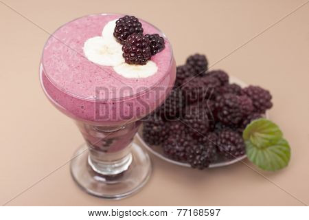 ?ocktail Of  Banana With Frozen  Blackberries And  Yogurt.