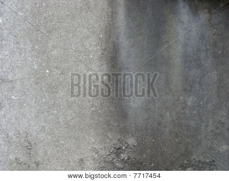 dirty gray wall with excessive dirt on one side