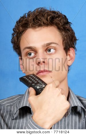 Pondering Young Man With Remote Control