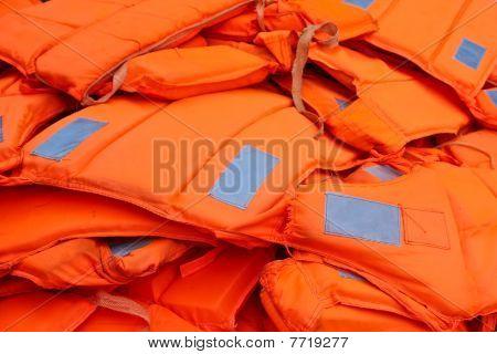 Pile Of Orange Life-jackets