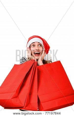 Young woman with shopping bags on Christmas