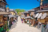 Tourists are walking on Gion district in Kyoto, Japan. poster
