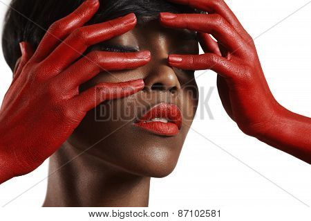 Beauty Black Woman With A Red Lips And Red Hands