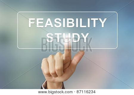 Business Hand Clicking Feasibility Study Button On Blurred Background