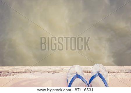 White Rubber Shoe On Cement Edge Near Sea