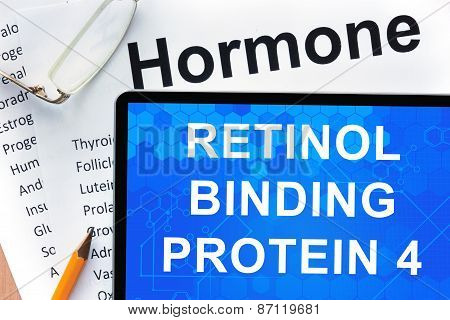 Papers with hormones list and tablet  with words  retinol binding protein 4 (RBP4). Medical concept poster